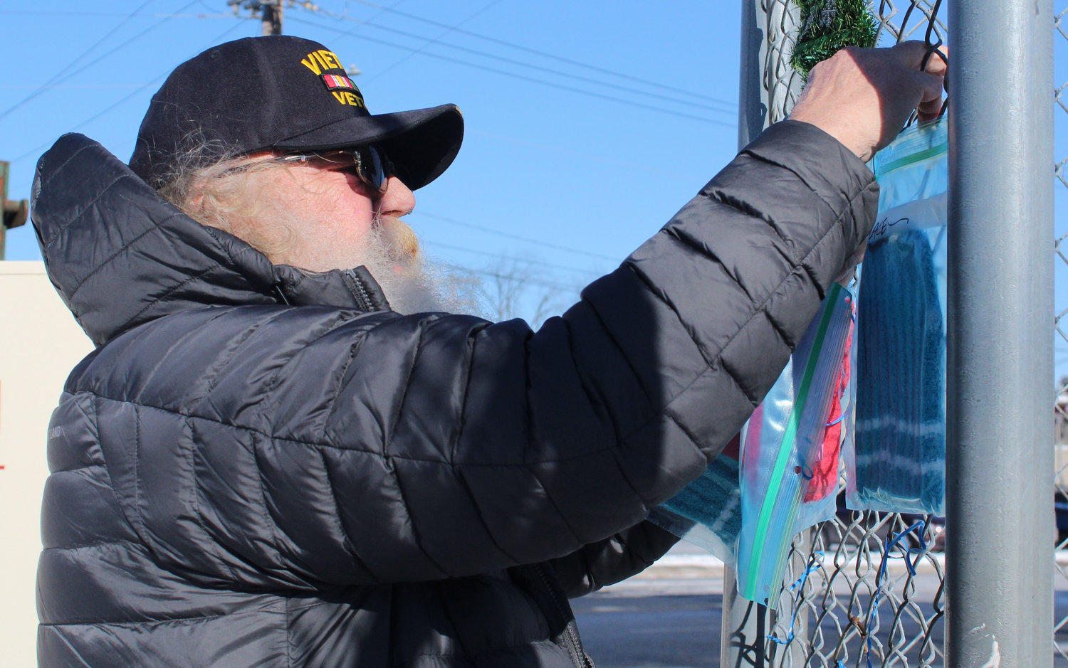 For the past several weeks, Dave Lidle has been hanging hats, gloves, socks and scarves outside the entrance to the subway near Karns for people to take for free.