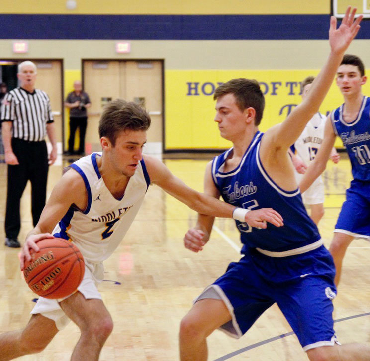 Tyler Petroski tries to get by a Falcon defender Feb. 8 in Middletown's 78-36 home loss against Lower Dauphin.