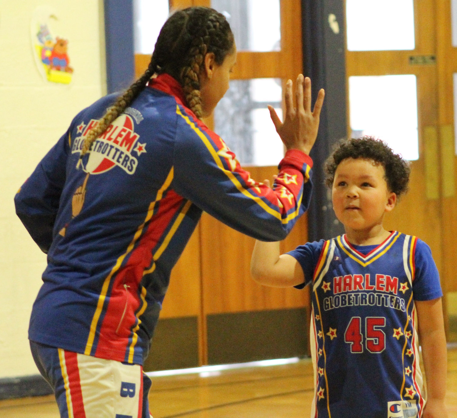 "Harlem Globetrotter Briana ""Hoops"" Green surprised Kyrie Peay in his preschool classroom at Seven Sorrows on Feb. 13 with a jersey and tickets."