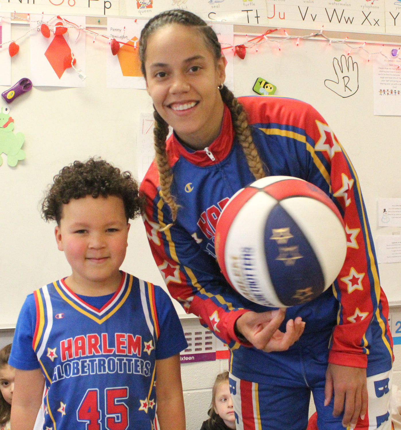 "Harlem Globetrotter Briana ""Hoops"" Green surprised Kyrie Peay in his preschool classroom at Seven Sorrows on Feb. 6 with a jersey and tickets."
