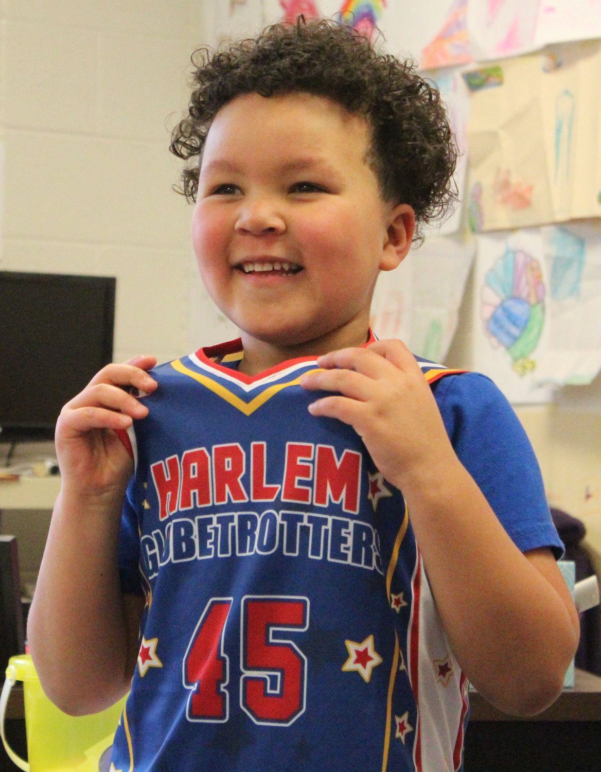 Kyrie Peay shows off his new Globetrotter jersey in his preschool classroom at Seven Sorrows on Feb. 6.