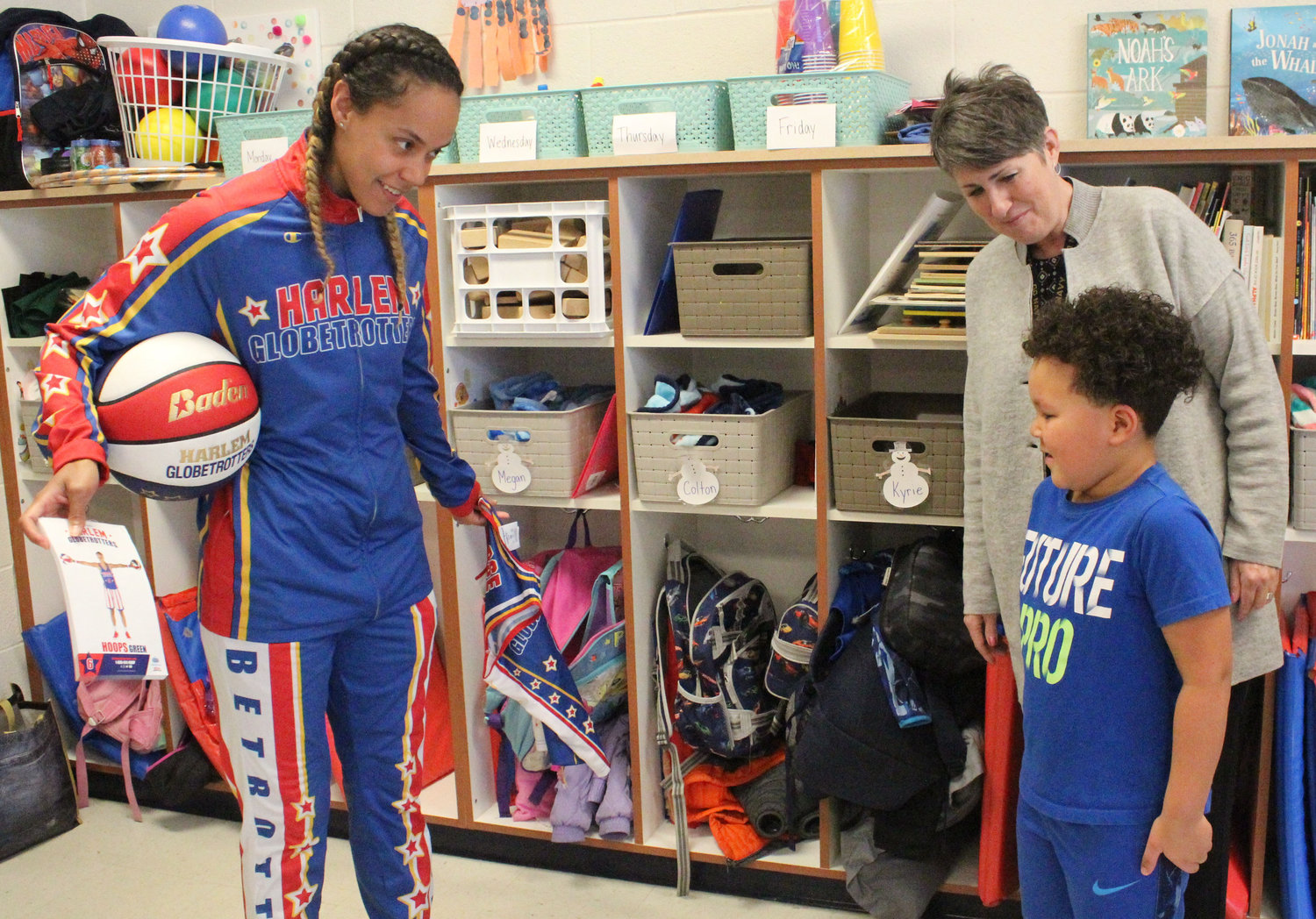 "Harlem Globetrotter's Briana ""Hoops"" Green surprised Kyrie Peay in his pre-school classroom at Seven Sorrows on Feb. 6 with a jersey and tickets."