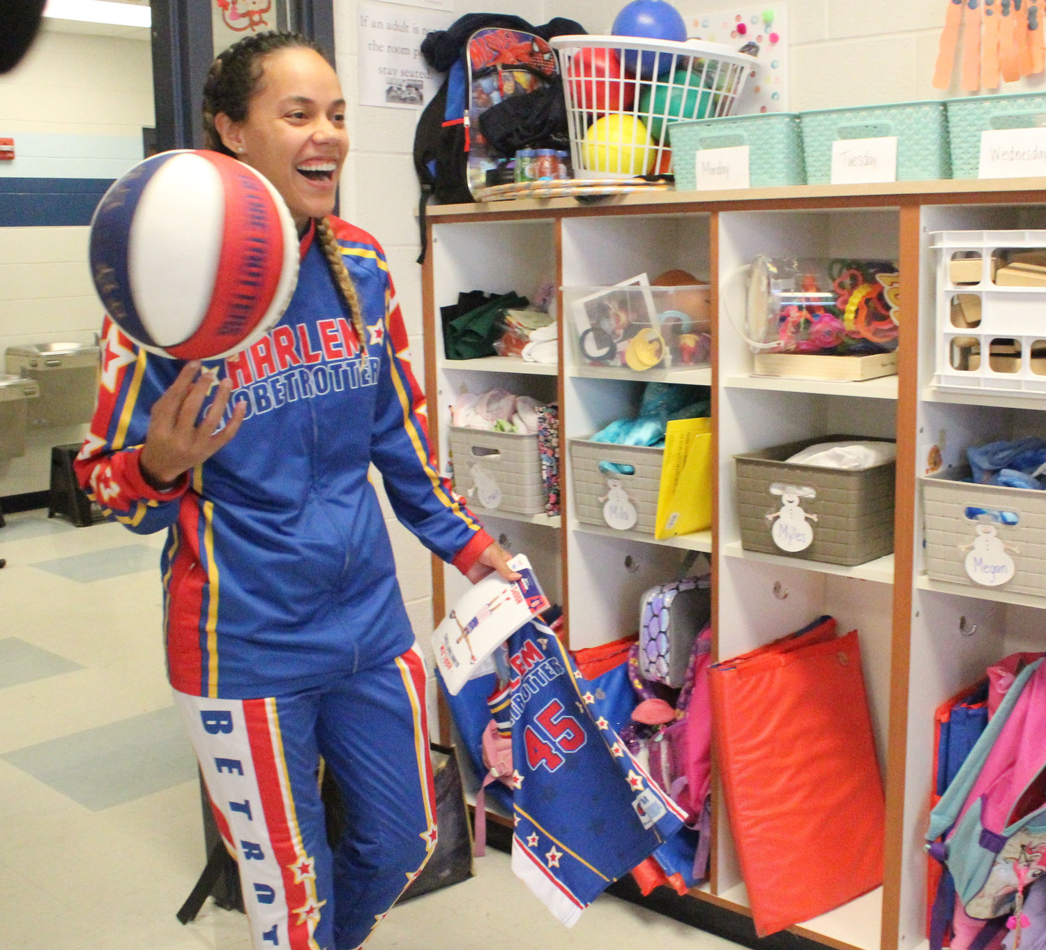 "Harlem Globetrotter Briana ""Hoops"" Green is all smiles as she enters Kyrie Peay's classroom at Seven Sorrows on Feb. 6."