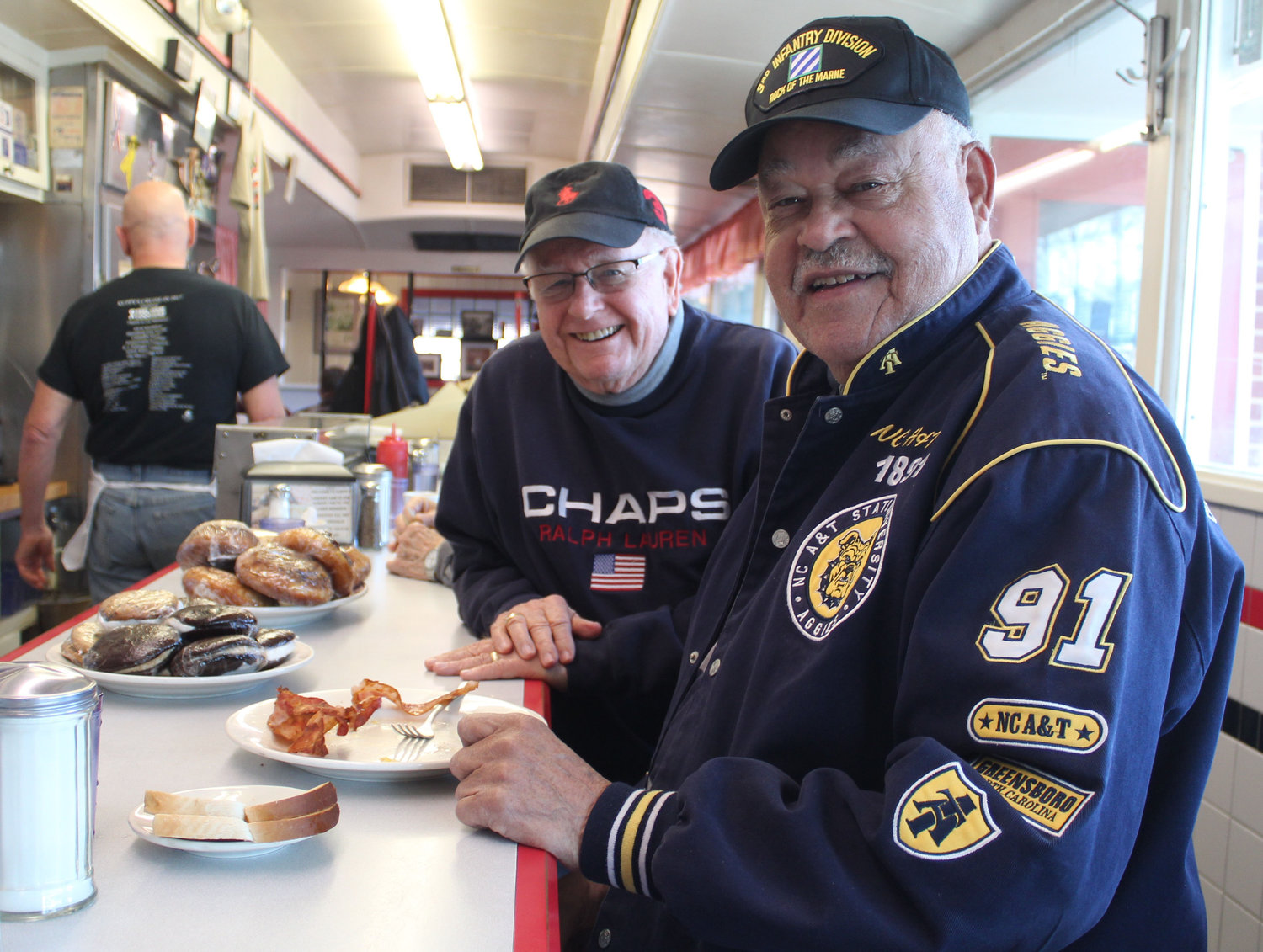 Mayor Robert Reid and Karl Kupp have breakfast together at Kuppy's on Feb. 19.