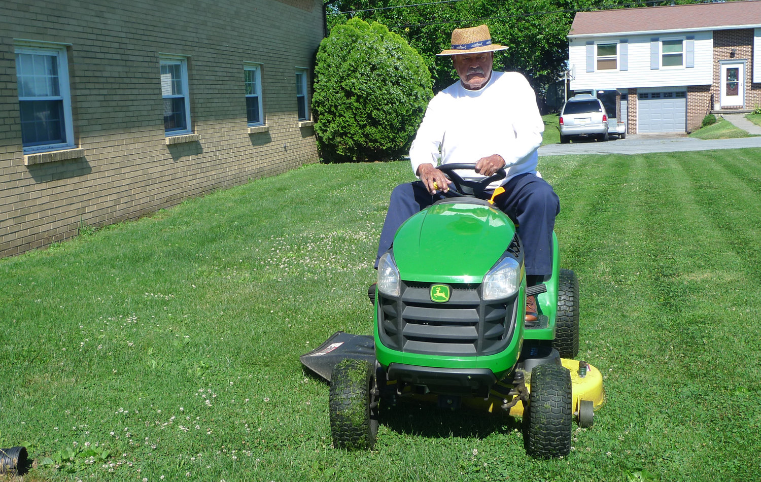 Once a week during the spring and summer, Robert Reid can be found behind the wheel of a tractor mowing the lawn of his church, the Ebenezer African Methodist Episcopal Church on Market Street in Middletown.