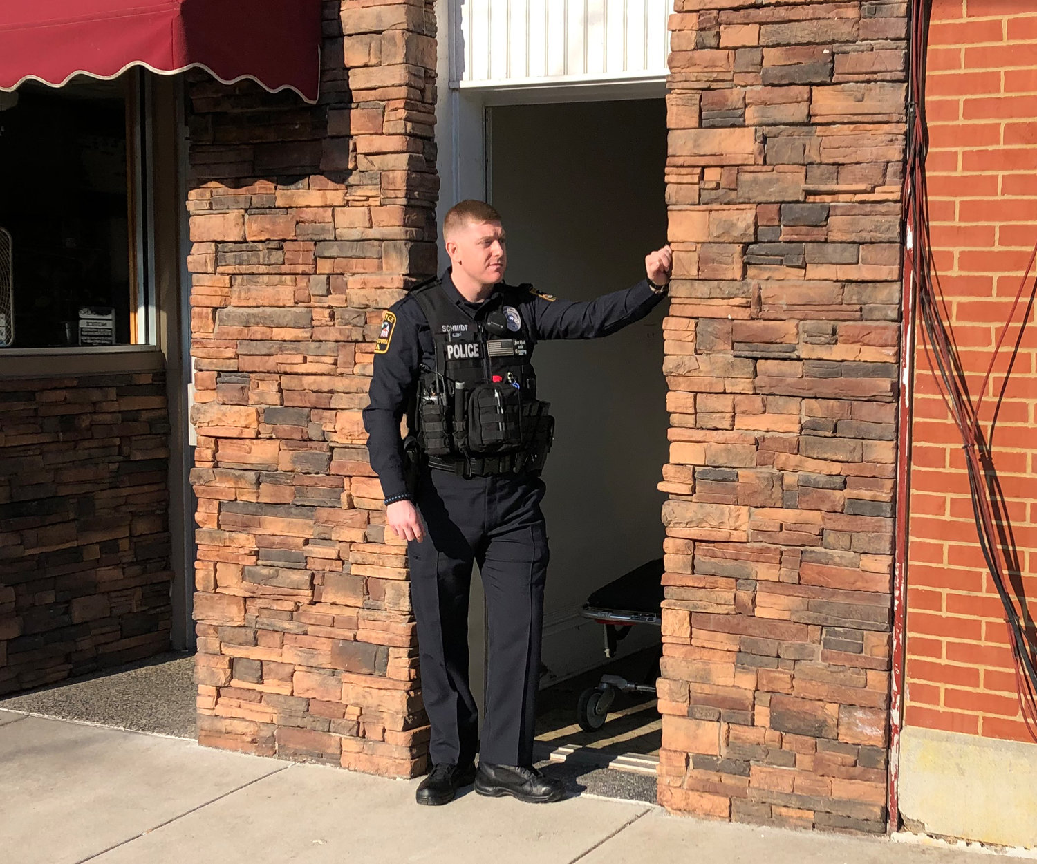 Police Officer Robert Schmidt stands watch outside 21 S. Union St. on Thursday morning. Authorities say there was a death in an apartment on the second floor.