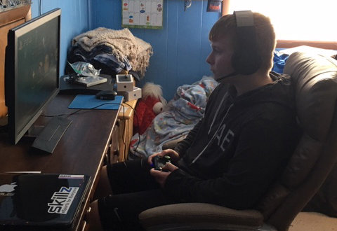 Mason Garza plays video games at his home.