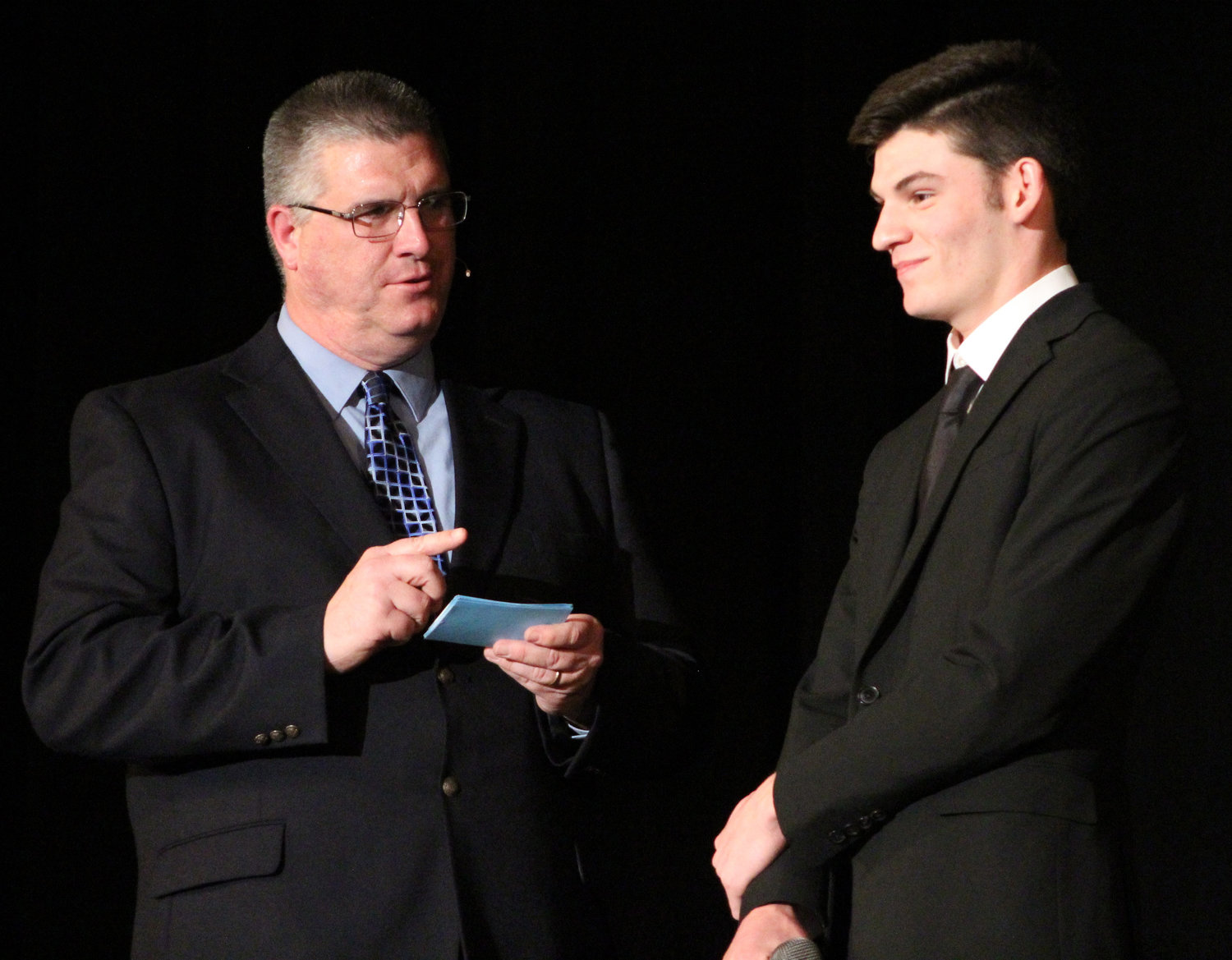 Scott Ash answers emcee Brian Keyser's question during Mr. Middletown on March 29.