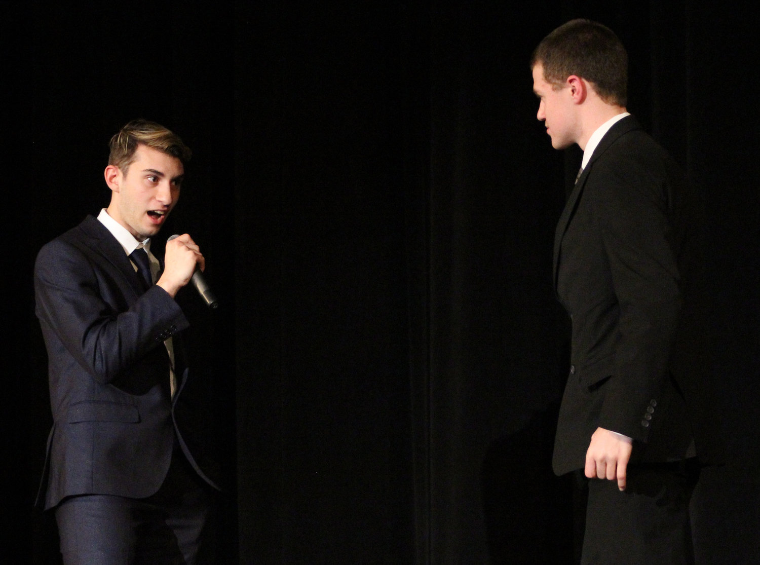 Anthony LaVia answers emcee Tim Nevil's question during Mr. Middletown on March 29.