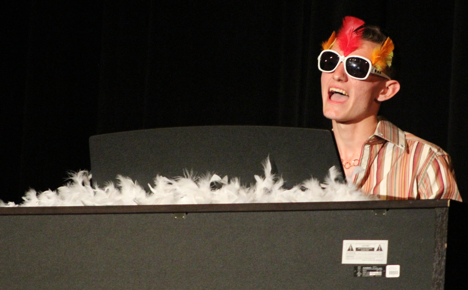 "Nathan Witmer lipsyncs to Elton John's ""Crocodile Rock"" during Mr. Middletown on March 29."