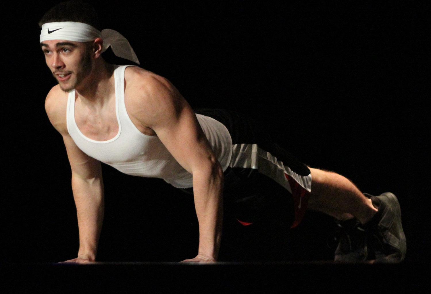 Tanner Albright does push-ups during the talent portion of Mr. Middletown on March 29.