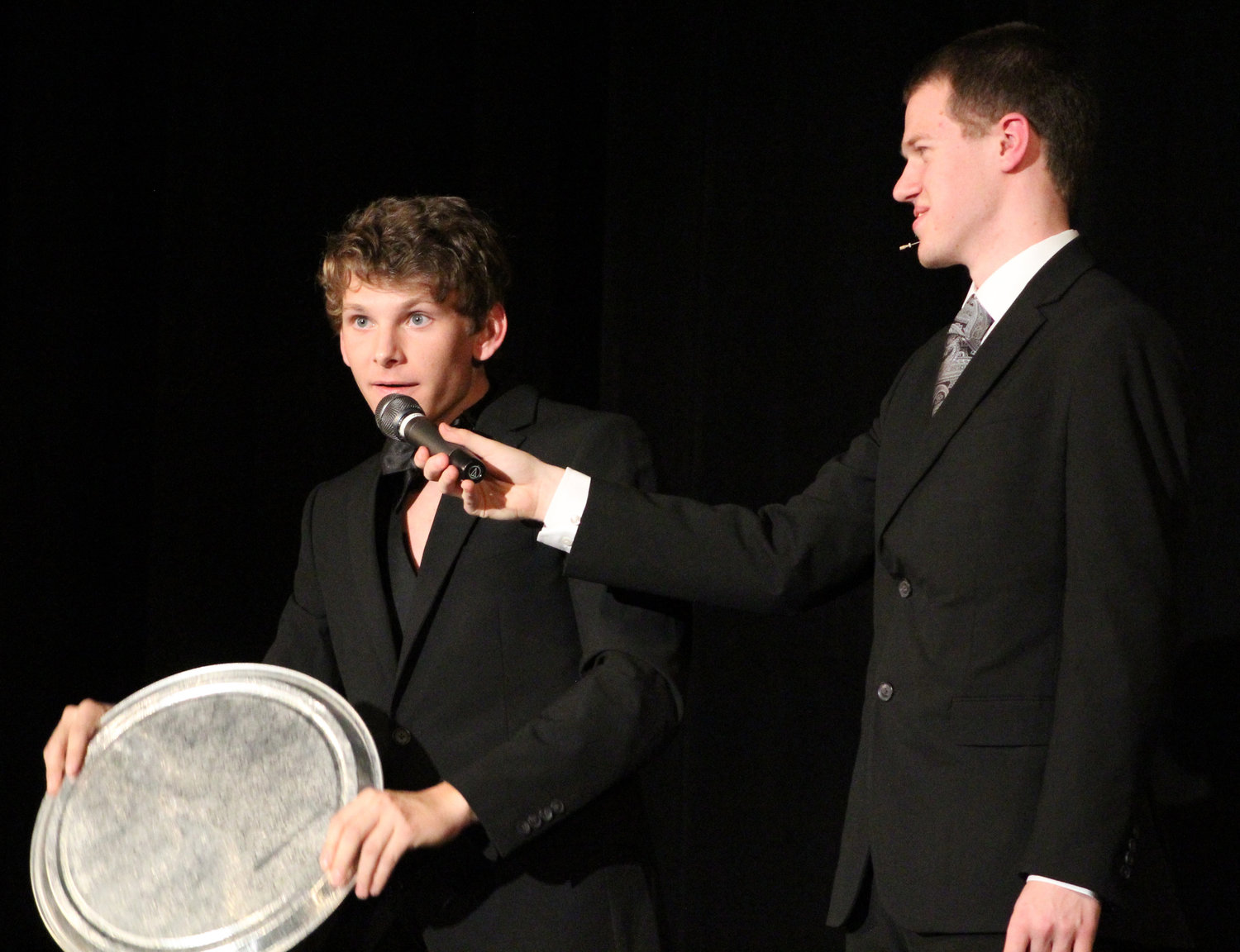 Ben Knisely discusses whether the Earth is flat with emcee Tim Nevil during Mr. Middletown on March 29.