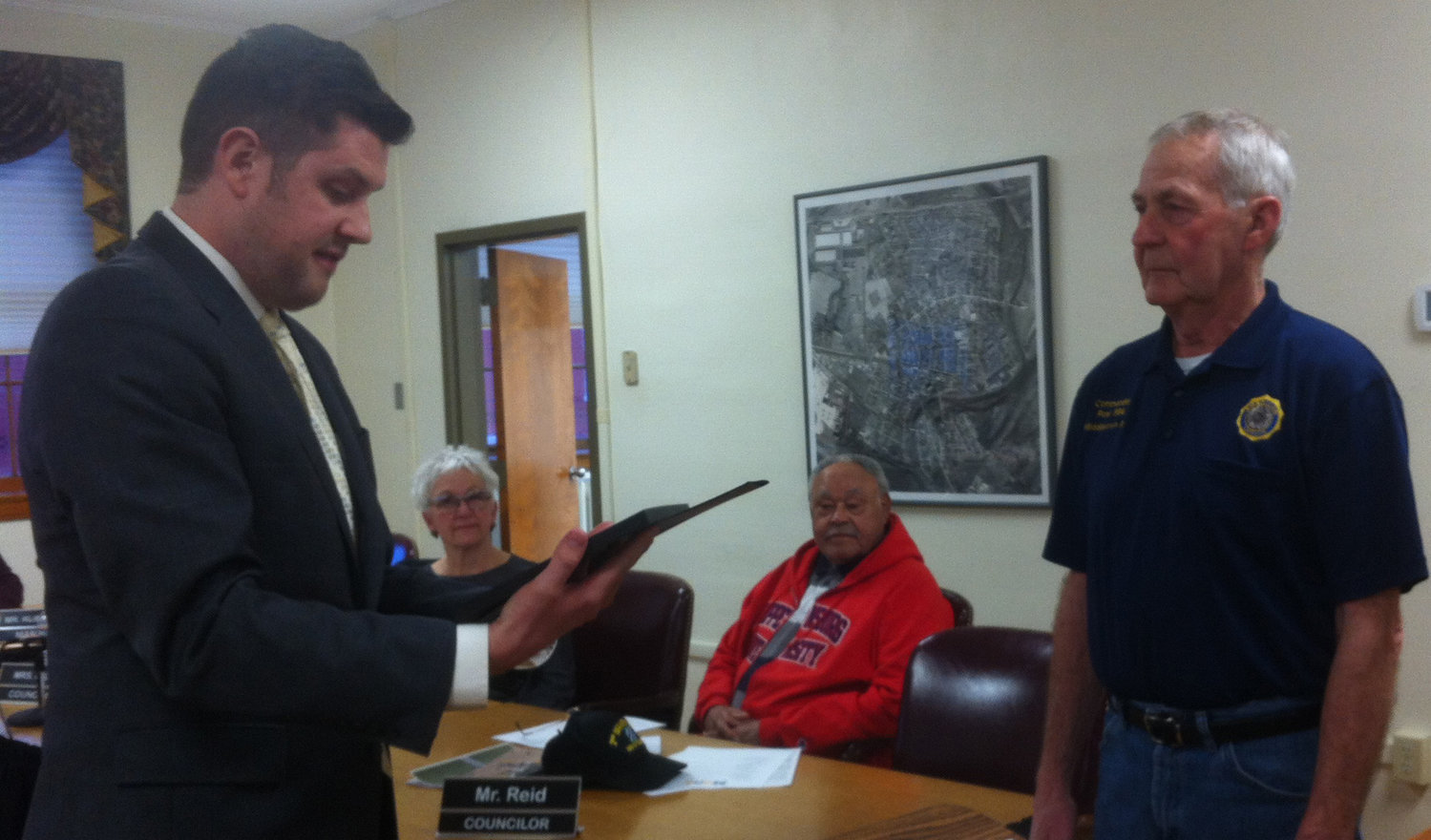 Mayor James H. Curry III reads the proclamation honoring the American Legion before presenting it to Post 594 Commander William Douglass at the start of the March 19 Middletown Borough Council meeting.
