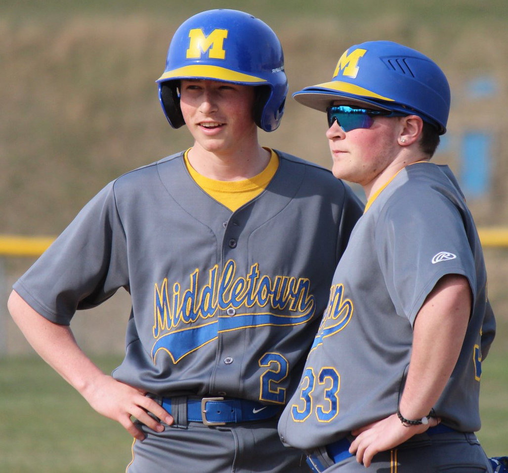Garrett Miller and Mike Tuffy chat April 4 during the Blue Raiders' game at Steelton-Highspire.