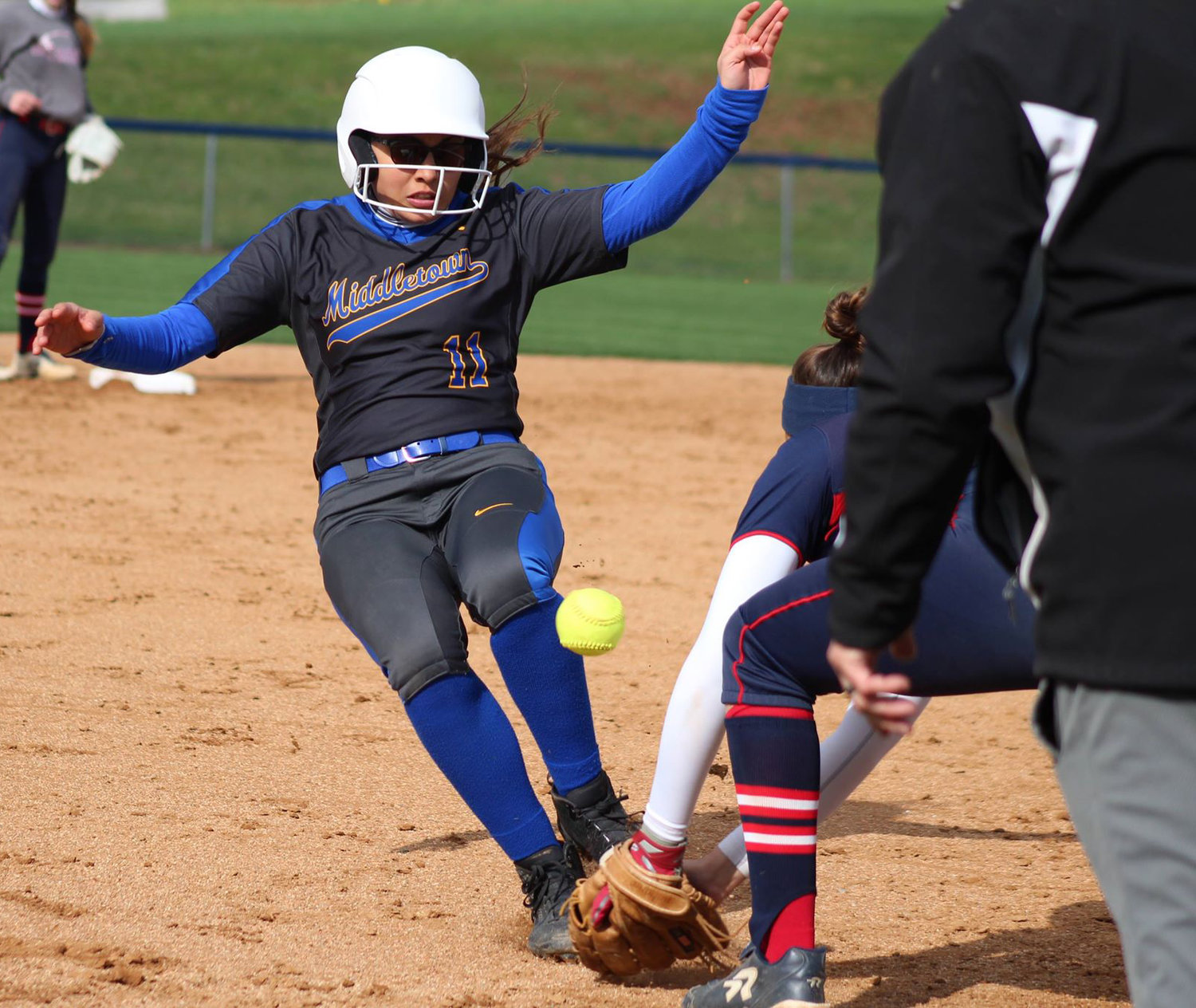 Camila Martinez slides into third during the April 15 home game against Red Land.