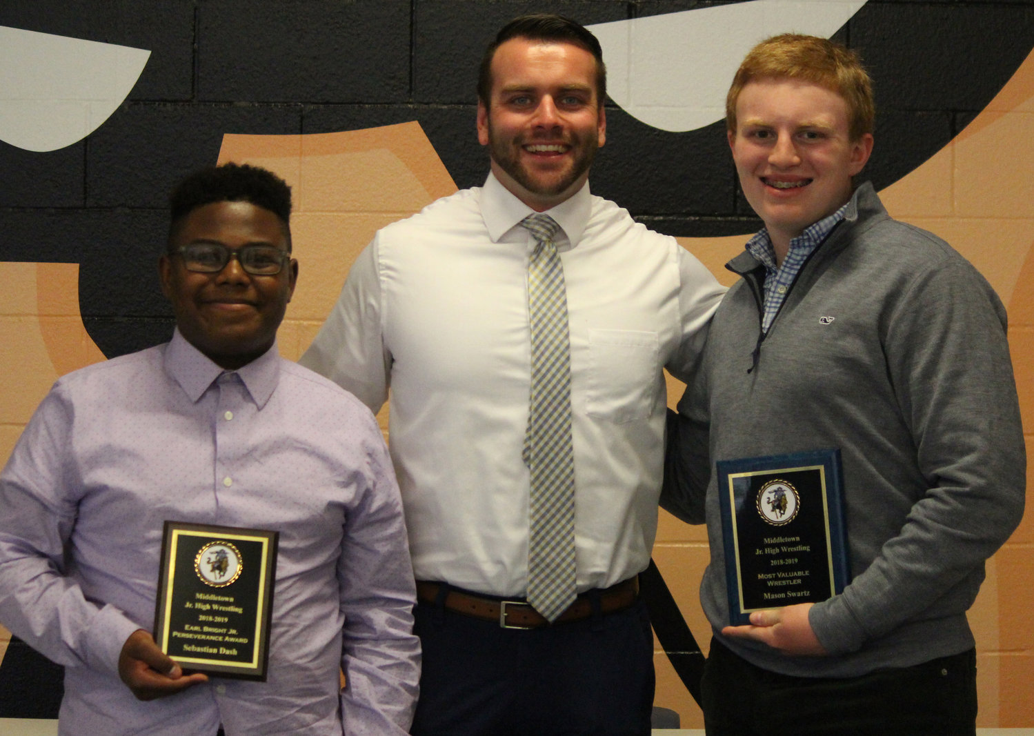 Junior high wrestling awards included Sebastian Dash (Earl Bright Jr. Perseverance Award), Coach Rob Brodish, and Mason Swartz (Most Valuable Wrestler Award).