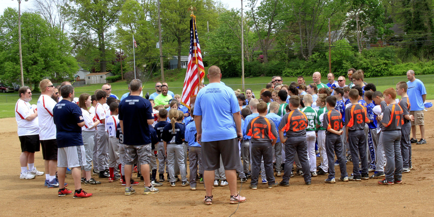 Middletown Amateur Baseball Association teams gather around the flag during opening day ceremonies in 2017.