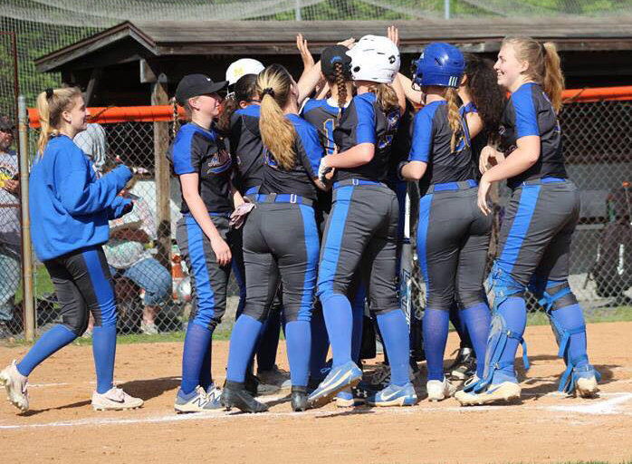 The MAHS softball team celebrates a Luvi Balliet homerun April 24 vs. East Pennsboro.