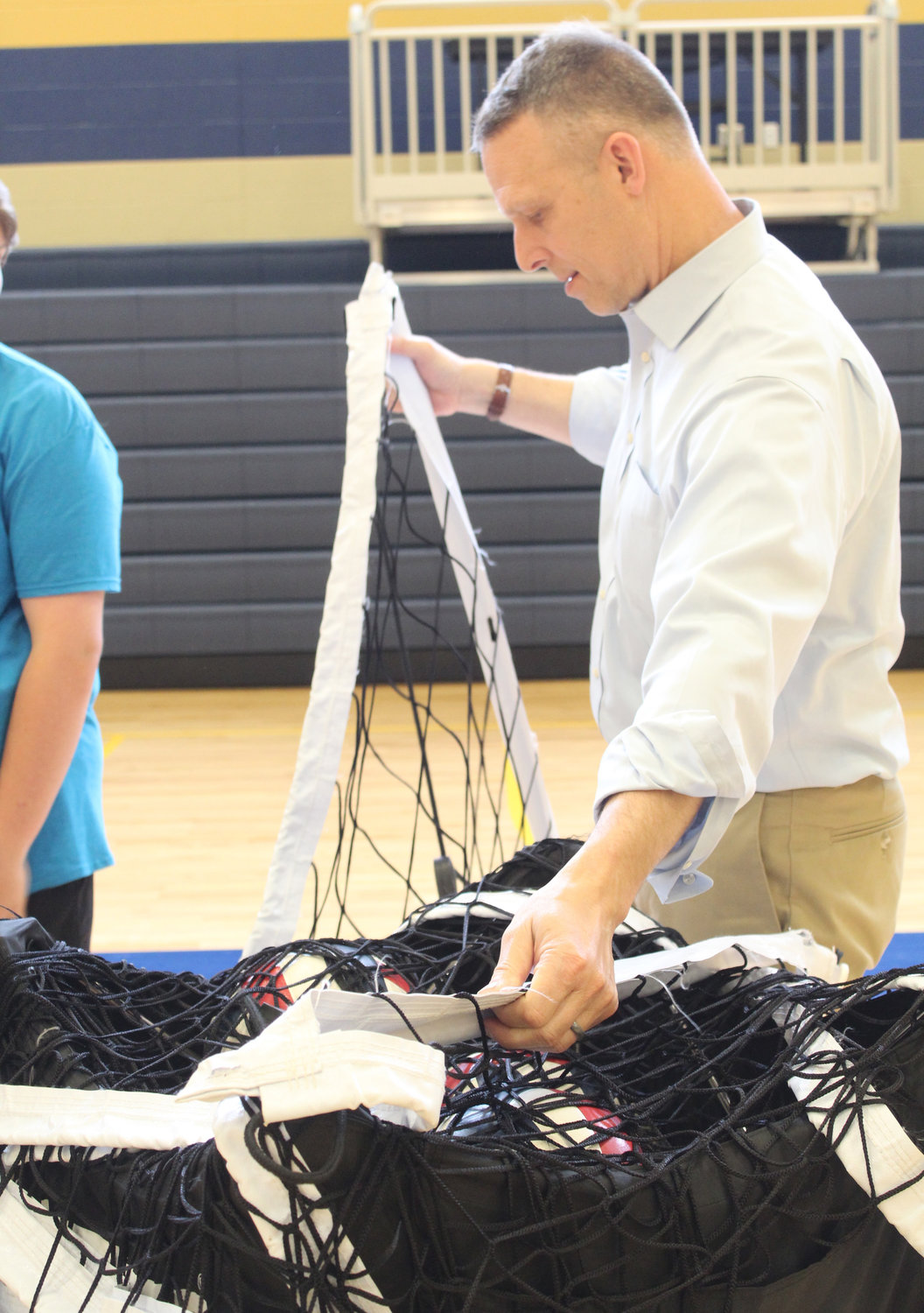 Congressman Scott Perry helps set up for MAHS' Mini-THON on May 3.