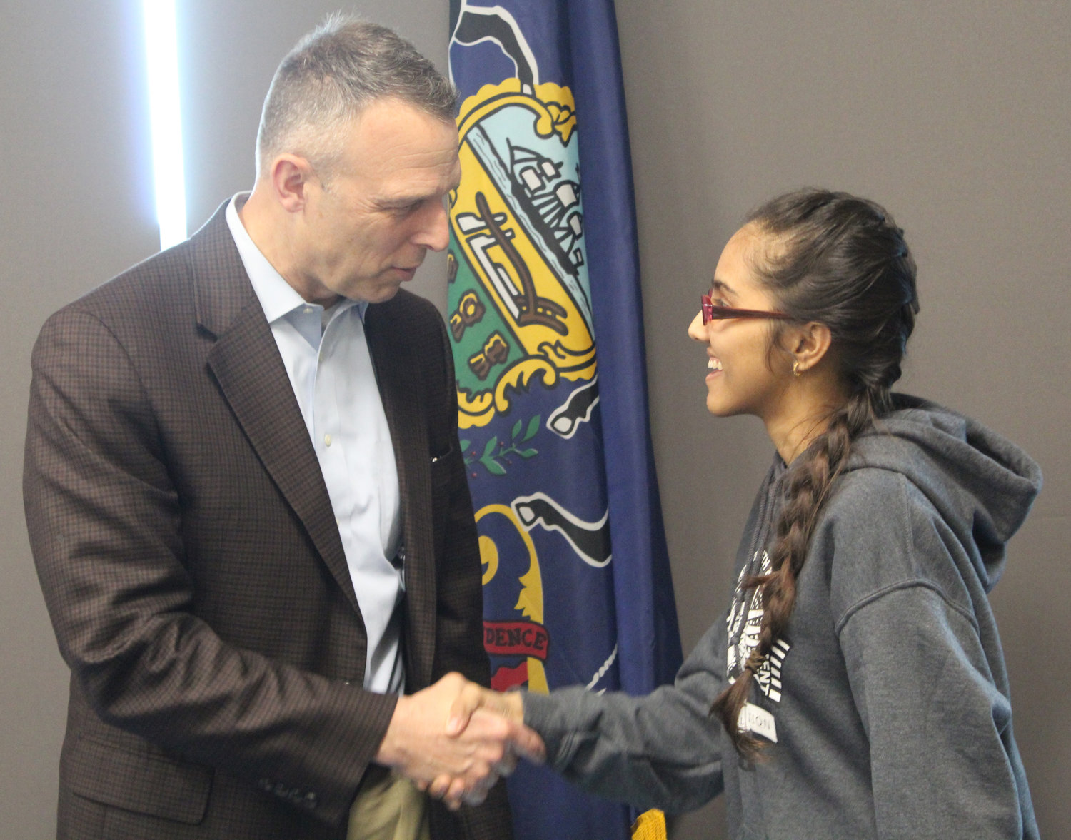 Congressman Scott Perry shakes hands with senior Aayushi Patel after meeting with the Youth & Government Club on May 3.