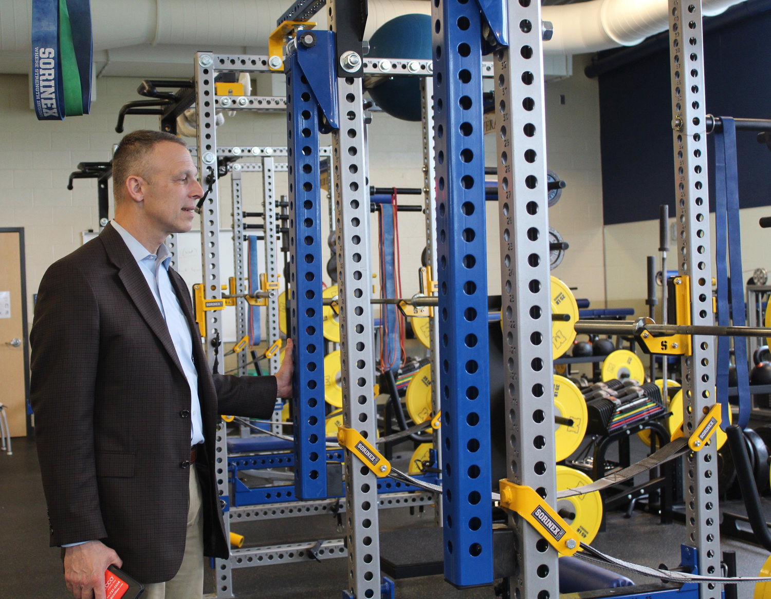 Congressman Scott Perry looks at the weight room during a tour of MAHS on May 3.