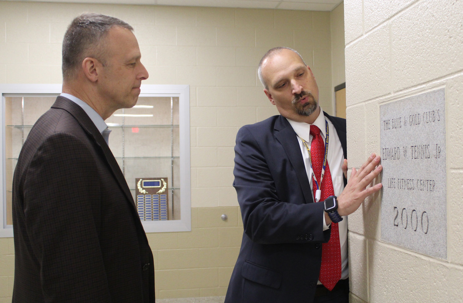 Principal Mike Carnes shows Congressman Scott Perry the dedication to Edward W. Tennis Jr. during a tour of MAHS on May 3.