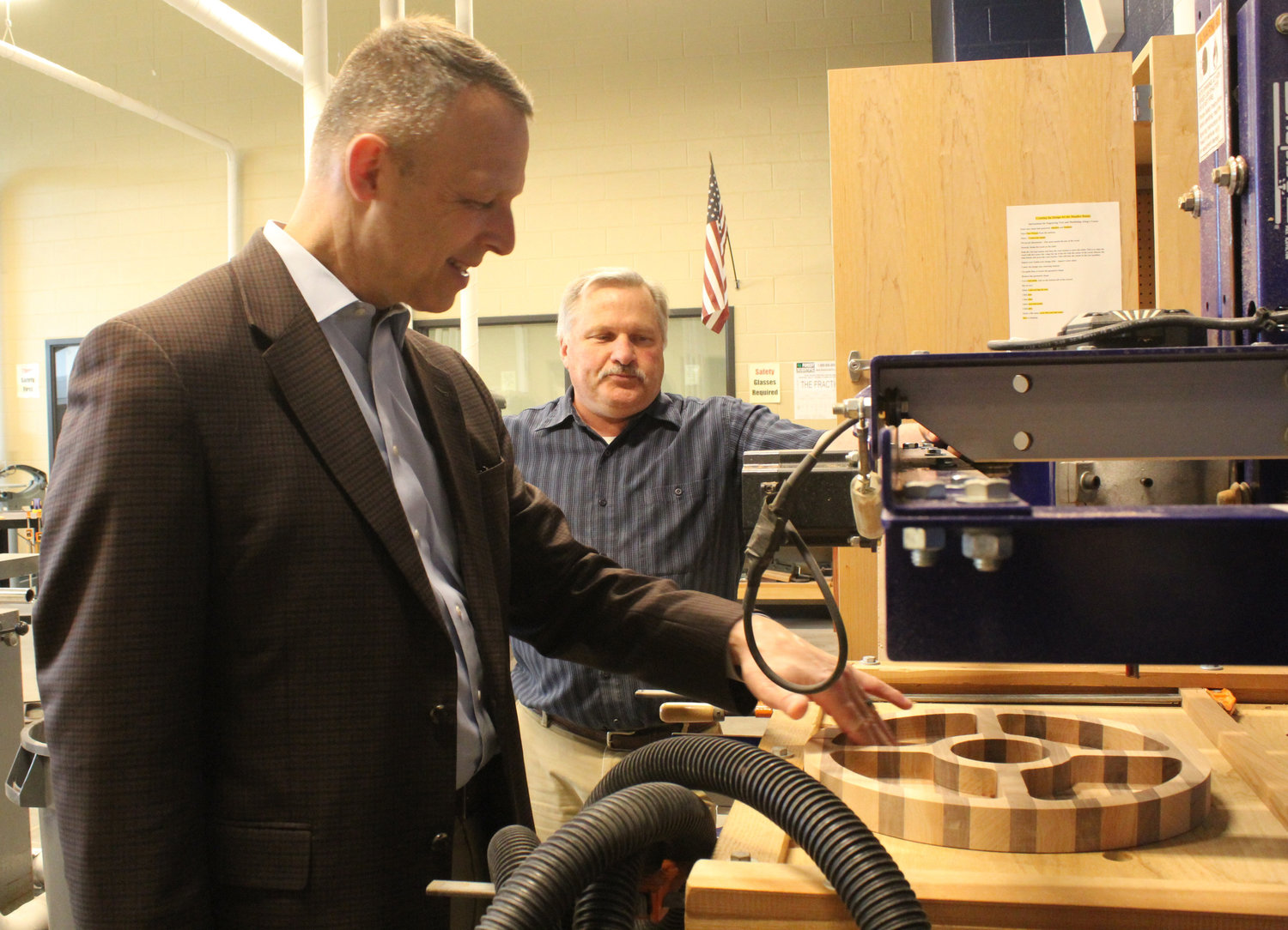 Teacher Robert Stitt shows Congressman Scott Perry the industrial technology equipment during a tour of MAHS on May 3.