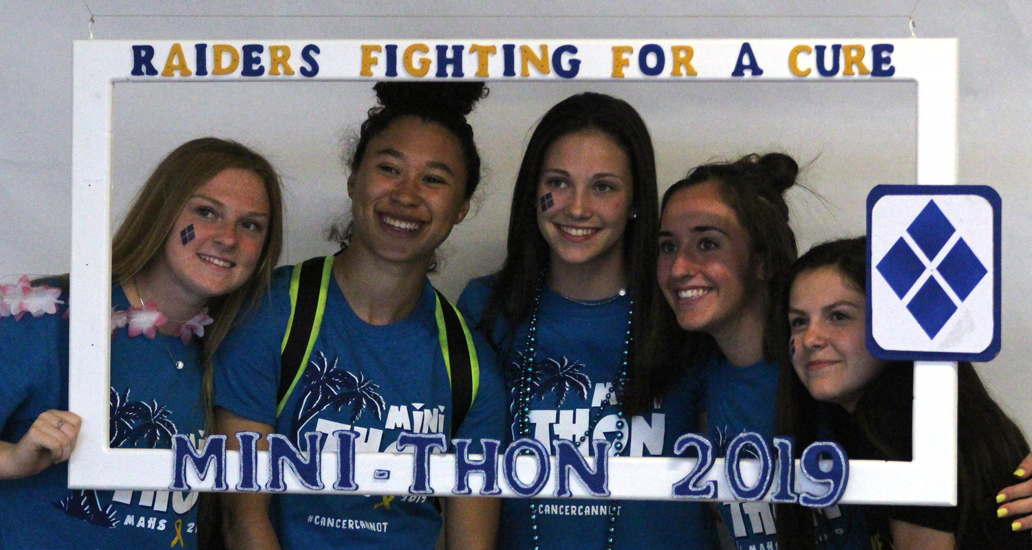 Jordan Dupes, Hayli Akakpo-Martin, Kiera Guckavan, Lexi Baumbach and Isabella Stillo take advantage of the license plate holder photo frame at Middletown Area High School's Mini-THON on May 3.