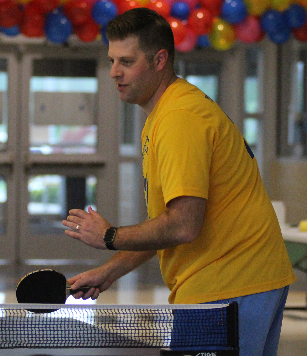 Teacher Chris Bradford plays pingpong during Middletown Area High School's Mini-THON on May 3.