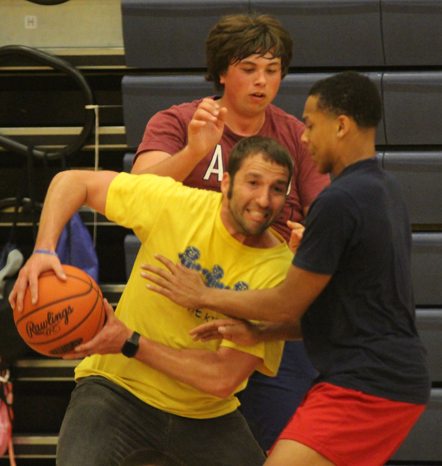 Teacher Jesse Woodrow plays basketball during Middletown Area High School's Mini-THON on May 3.