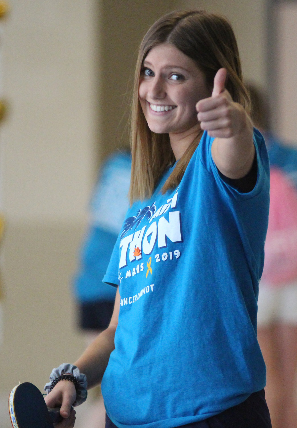 Marie Schopf enjoys pingpong at Middletown Area High School's Mini-THON on May 3.
