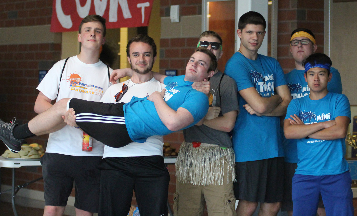 Caleb Springer and Case Woodley hold Joey Spear, along with Matt Monroe, Trevor Myers, Dane Ebersole and Zach Malay, at Middletown Area High School's Mini-THON on May 3.