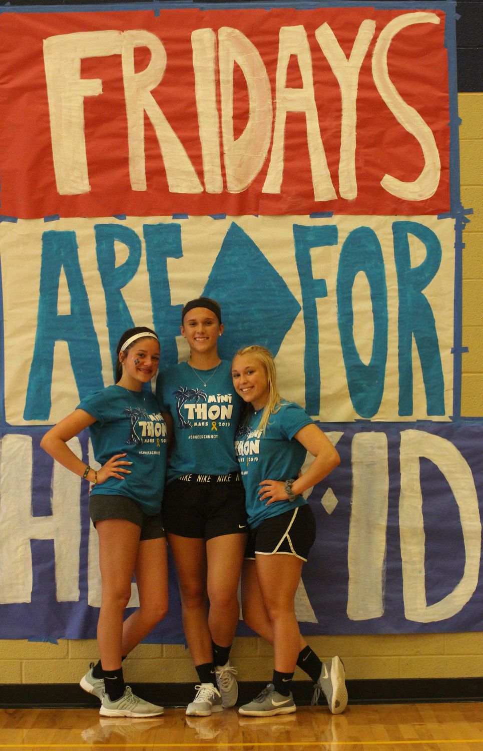 Lani Moore, Alex Kennedy and Hannah Wilsbach take part in Middletown Area High School's Mini-THON on May 3.
