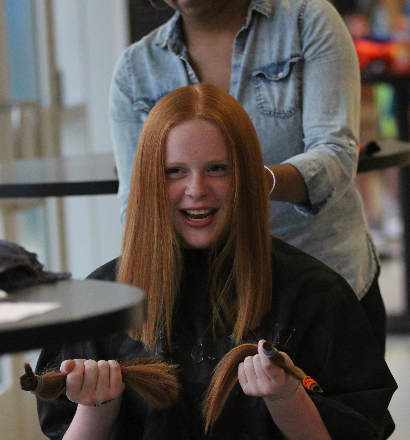 Abby Grimland reacts to her hair donation at Middletown Area High School's Mini-THON on May 3.