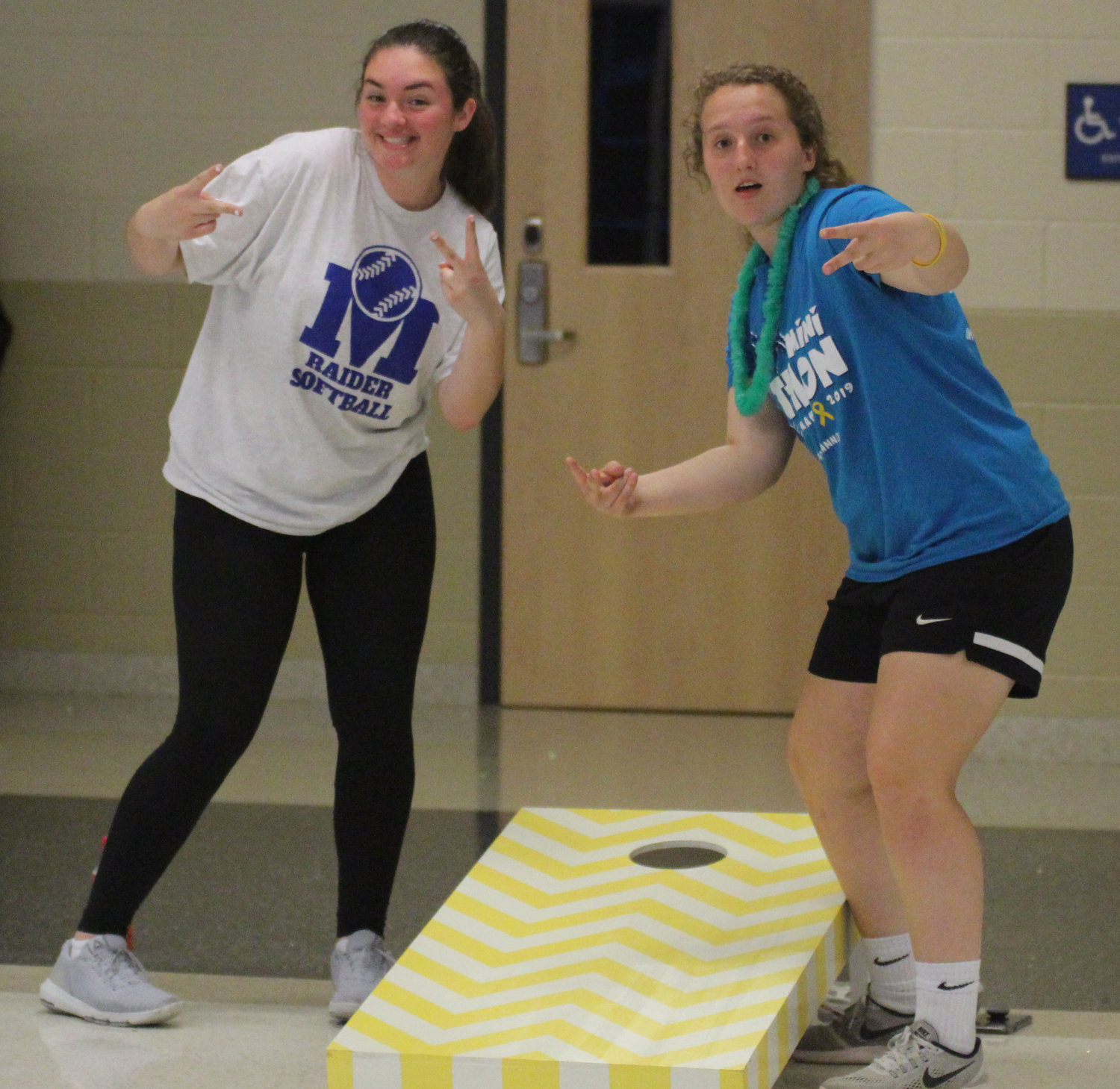 Emma Lovell and Amanda Lee play cornhole at Middletown Area High School's Mini-THON on May 3.