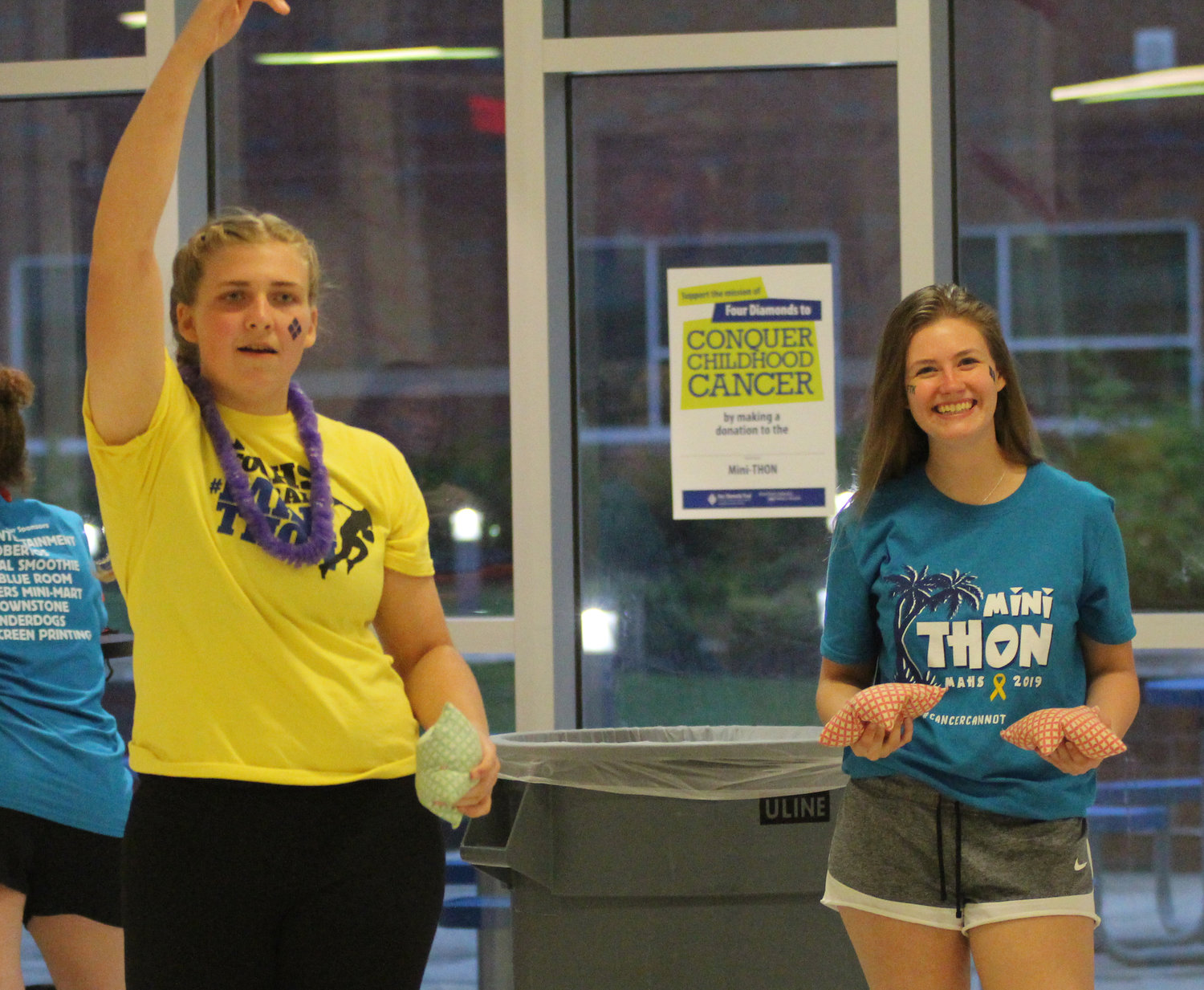 Sara Dintiman and Alex Fish play cornhole at Middletown Area High School's Mini-THON on May 3.