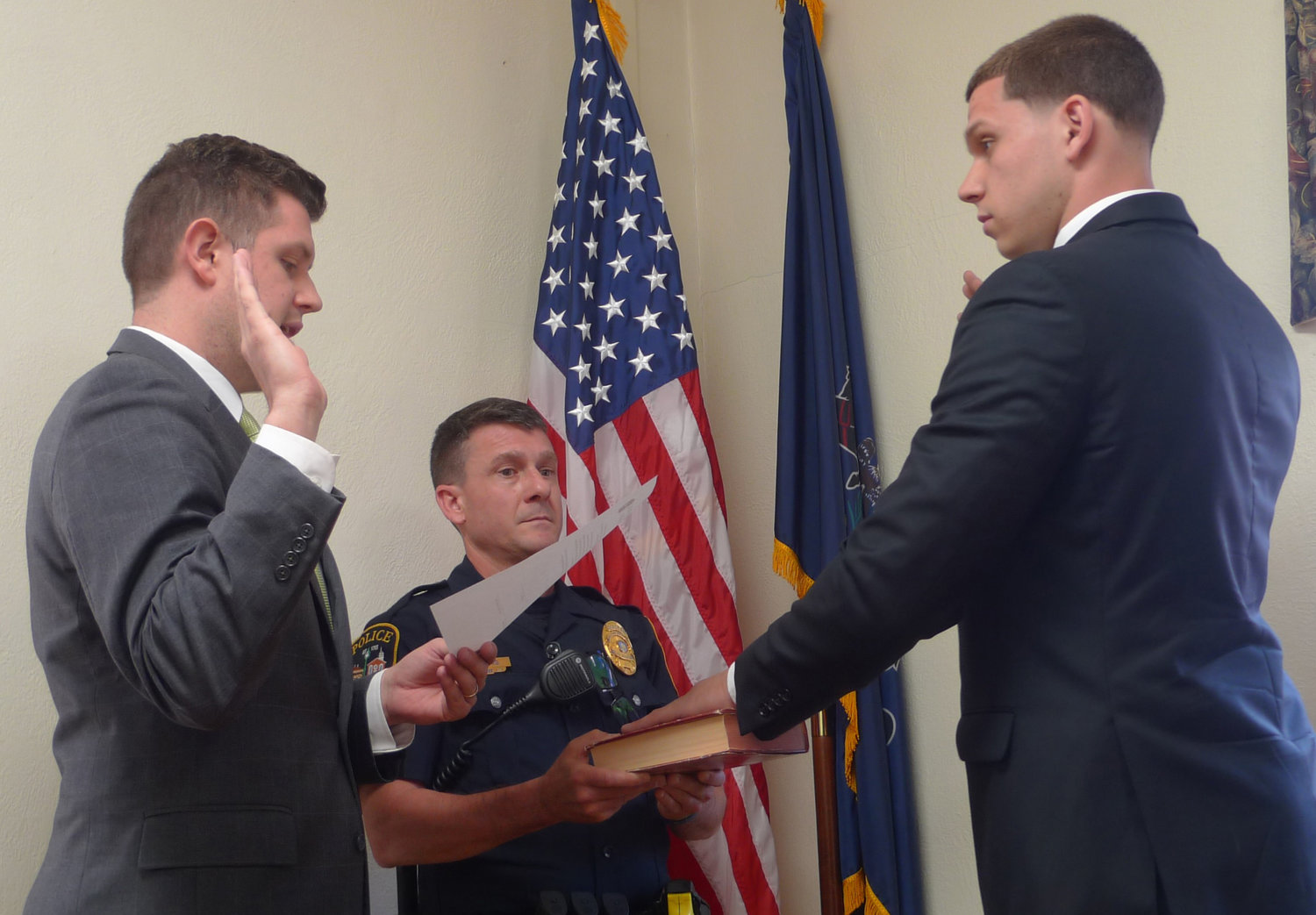 Middletown Mayor James H. Curry III swears in the borough's newest part-time police officer, John Marsh, as interim Police Chief Dennis Morris observes (middle) during borough council's May 8 meeting.