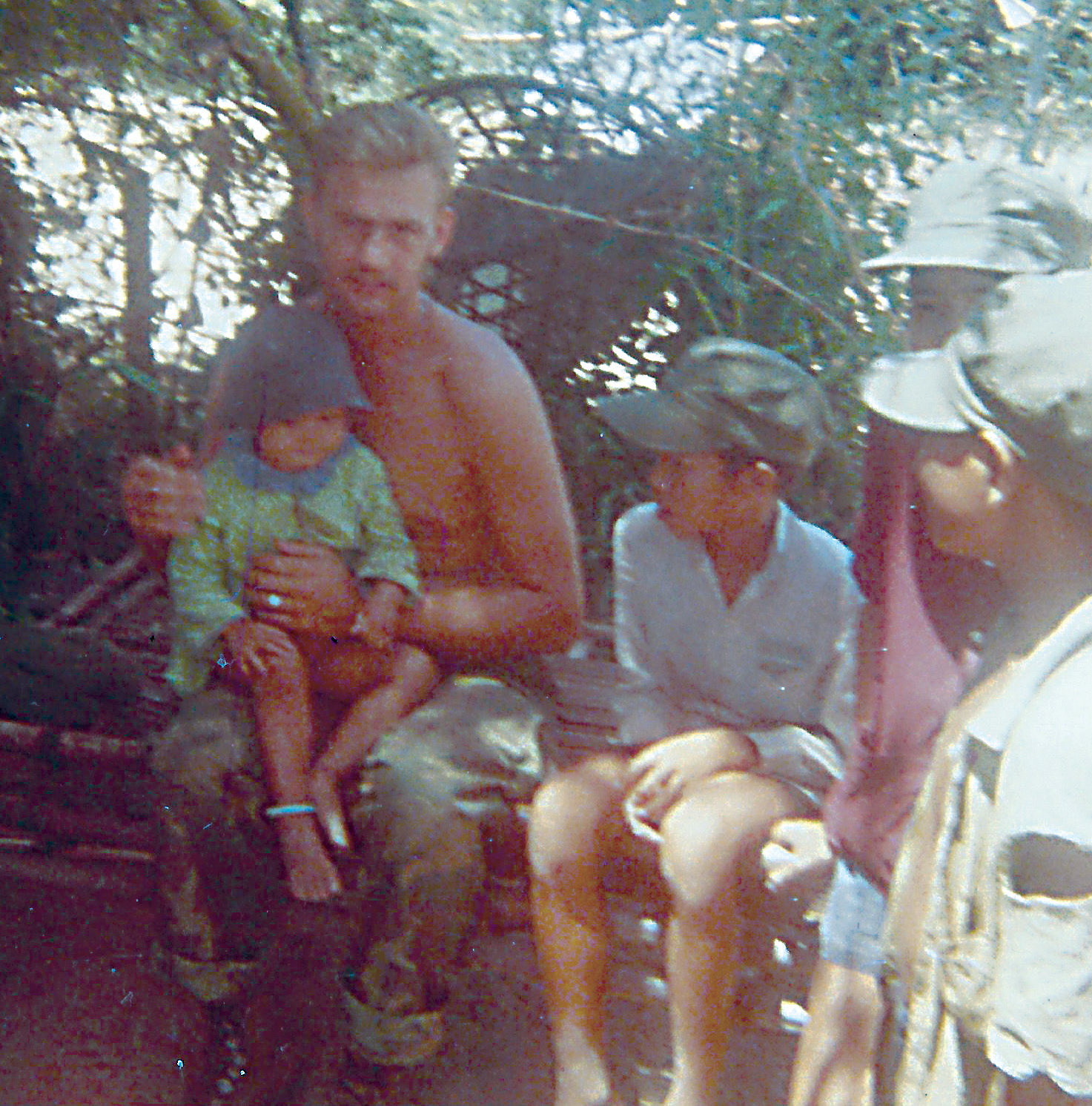 Ken Shaffer sits with Vietnamese children sometime during his nearly one-year long deployment in the war as a Navy corpsman assigned to a Marine rifle company.