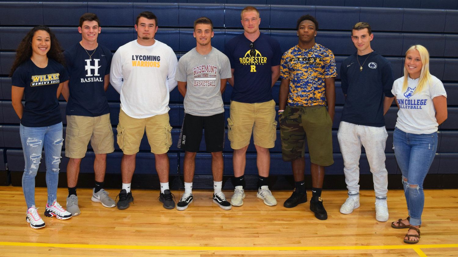 Eight Middletown Area High School seniors announced their college commitments May 28 at a signing ceremony held at MAHS. From left are Hayli Akakpo-Martin, who will play soccer at Wilkes University in Wilkes-Barre; Scott Ash, who will play baseball at Hood College in Frederick, Maryland; Joseph Gusler, who will play football at Lycoming College in Williamsport; Tyler Petroski, who will play basketball at Rosemont College in Rosemont; Ethan Miller, who will play football at the University of Rochester in Rochester, New York; Trayvon Joseph, who will play football at Thaddeus Stevens College in Lancaster; Anthony LaVia, who will play soccer at Penn State University Harrisburg; and Hannah Wilsbach, who will play volleyball at Penn College in Williamsport.