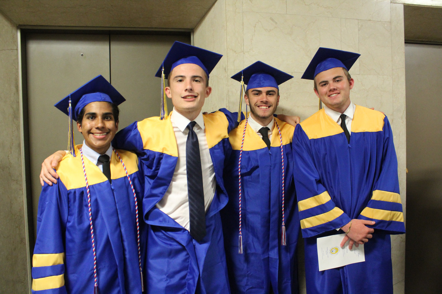 Edgar Lopez, Kenny Britcher, Tanner Albright and Ivan Henderson pose for photos before MAHS graduation June 4.