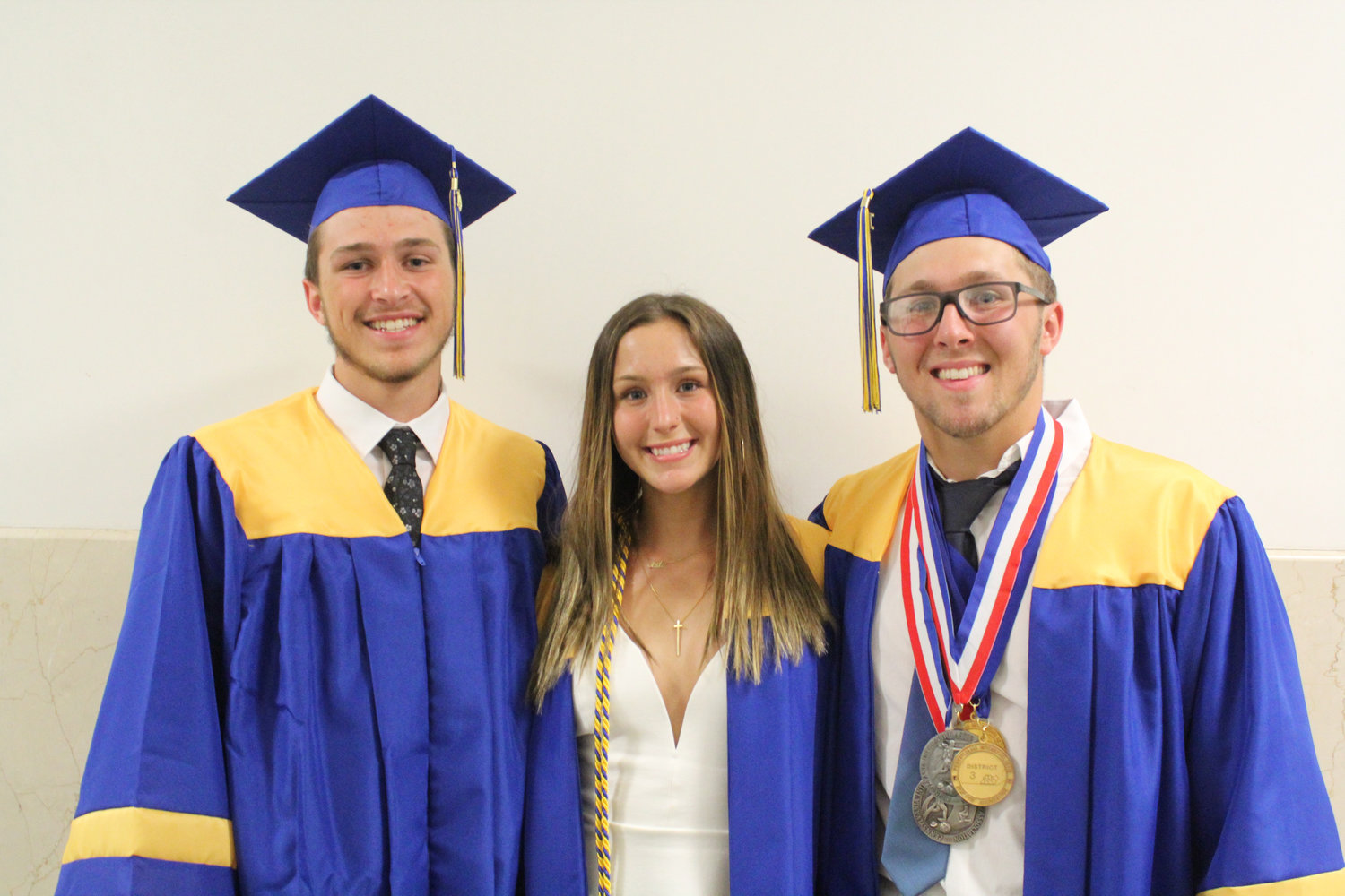 Jaxson, Jade and Cole Senior pose before graduation June 4.