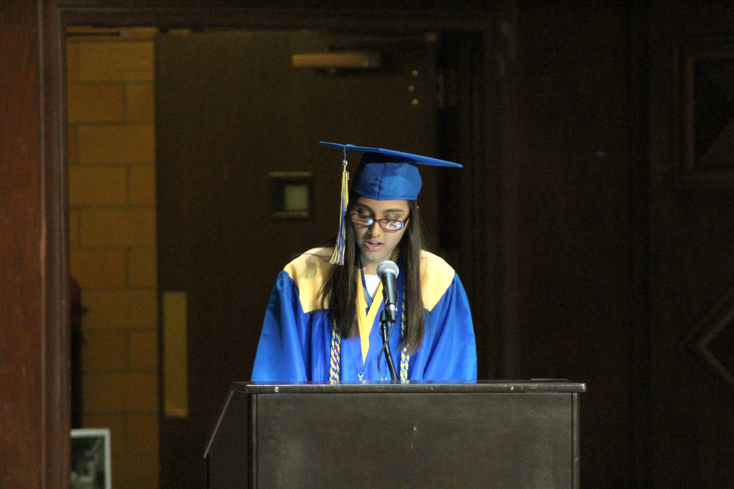 Salutatorian Aayushi Patel delivers the student welcome during graduation June 4.