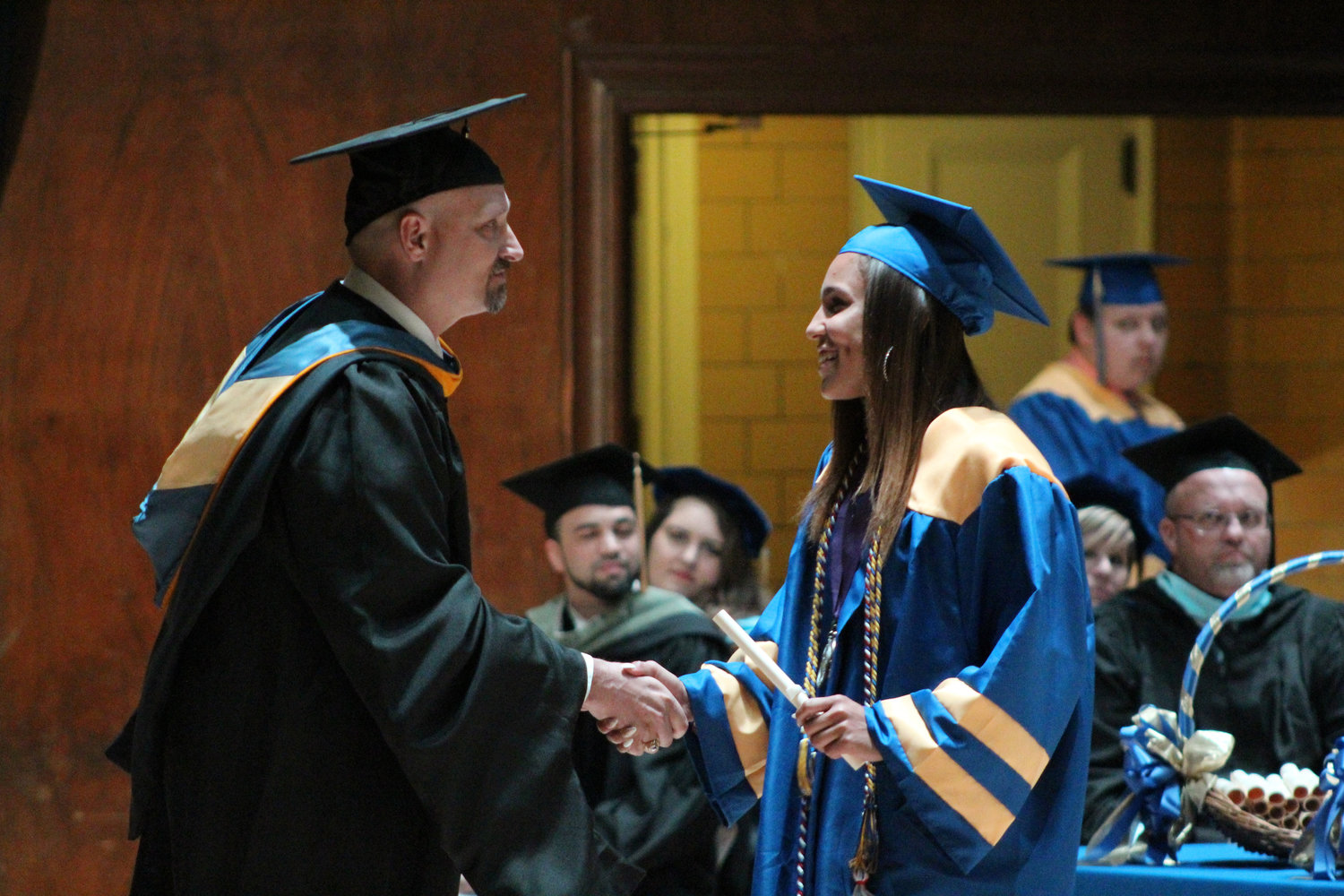 Jocilyn Koser shakes hands with MAHS Principal Michael Carnes during graduation June 4.