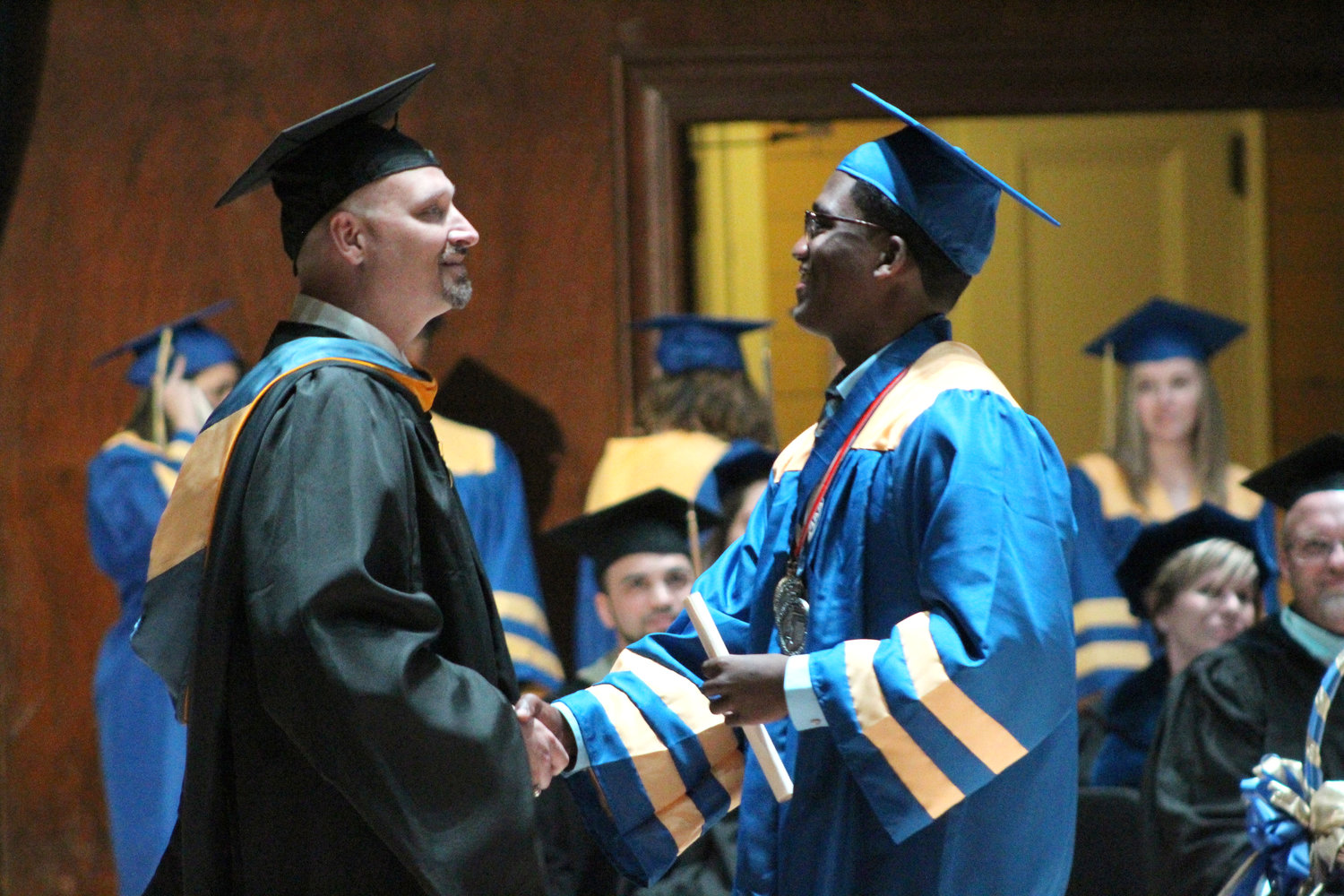 Adonis Taveras shakes hands with MAHS Principal Michael Carnes during graduation June 4.
