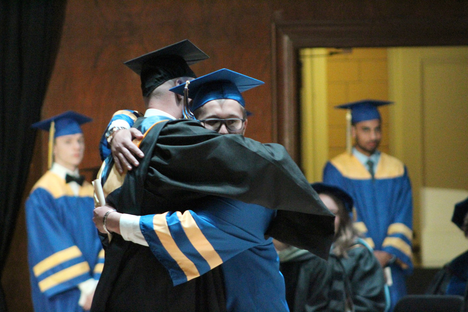 Cole Senior hugs MAHS Principal during graduation June 4.