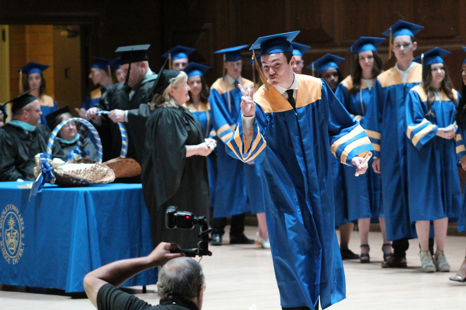 Christopher Reed poses for a photo during graduation on June 4.
