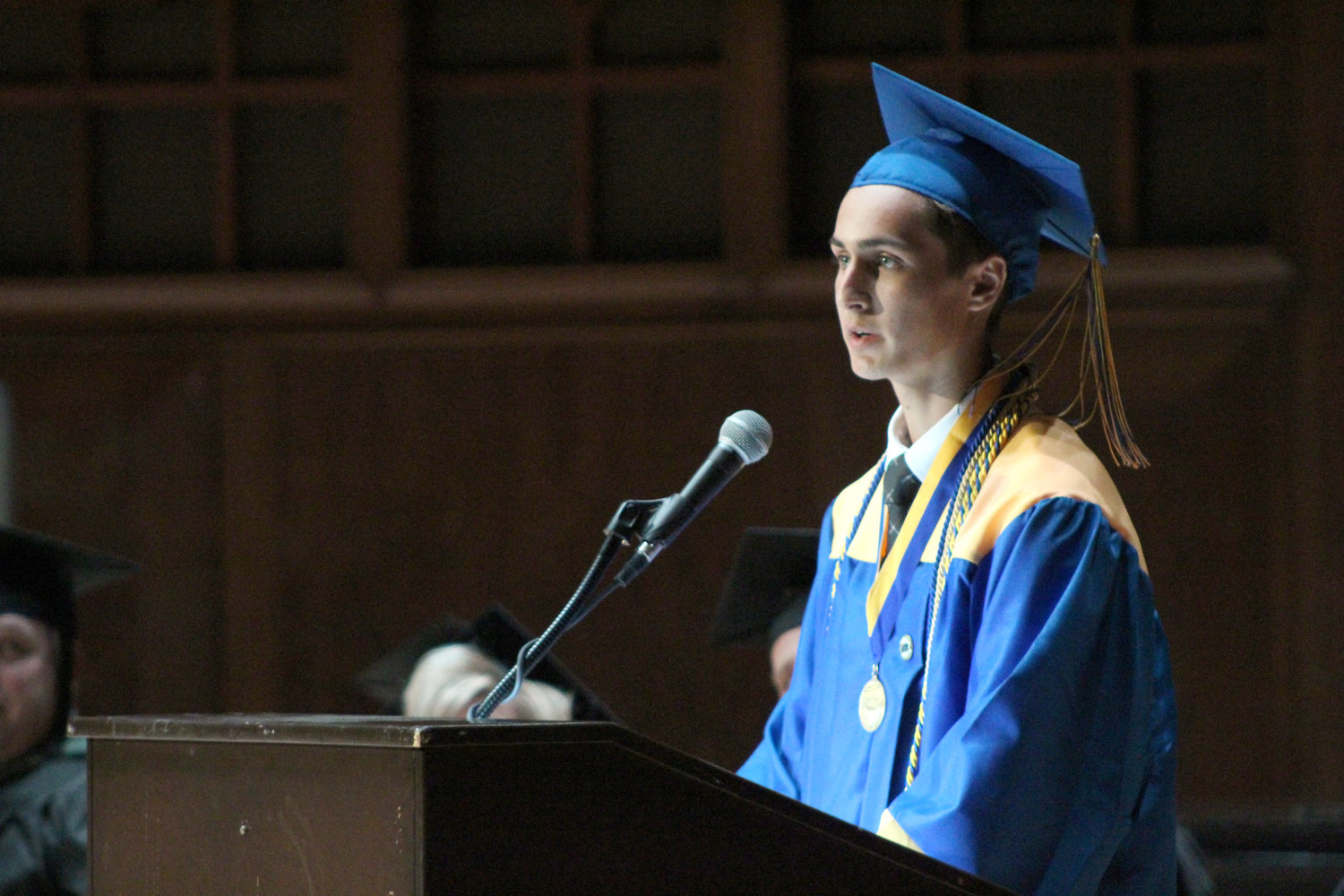 Valedictorian Aiden Sessa delivers the farewell during graduation on June 4.