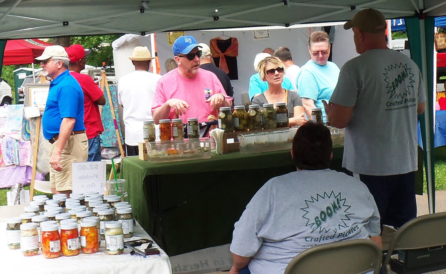 Attendees at the Middletown Area Historical Society's 44th annual Arts & Crafts Fair check out the selections at Boom Crafted Pickles stand. The business is run by Michelle Handley of Hershey.