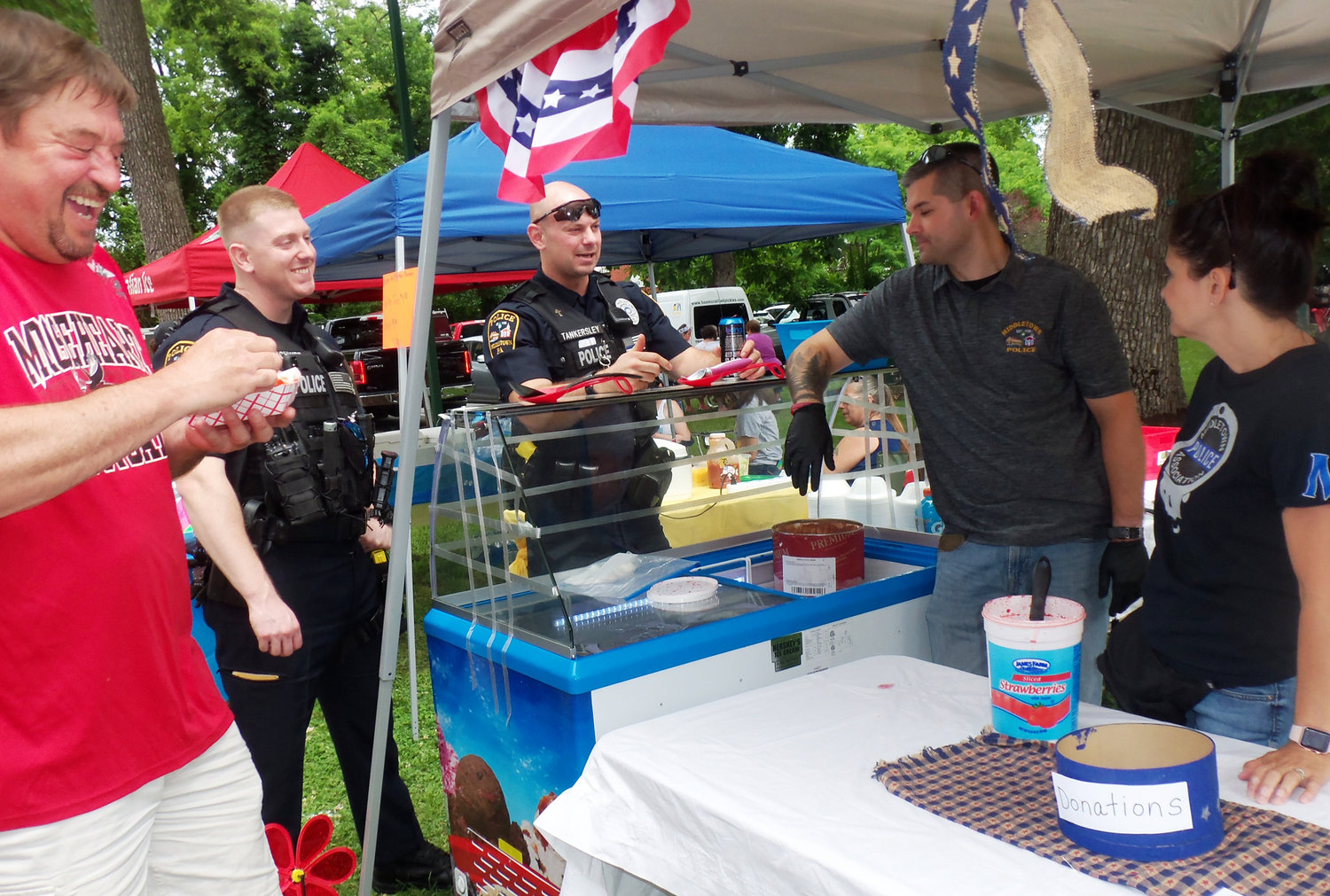 The Middletown Police Association raised funds by selling fresh strawberries with ice cream at the Middletown Area Historical Society's Arts & Crafts Fair on June 8 at Hoffer Park.