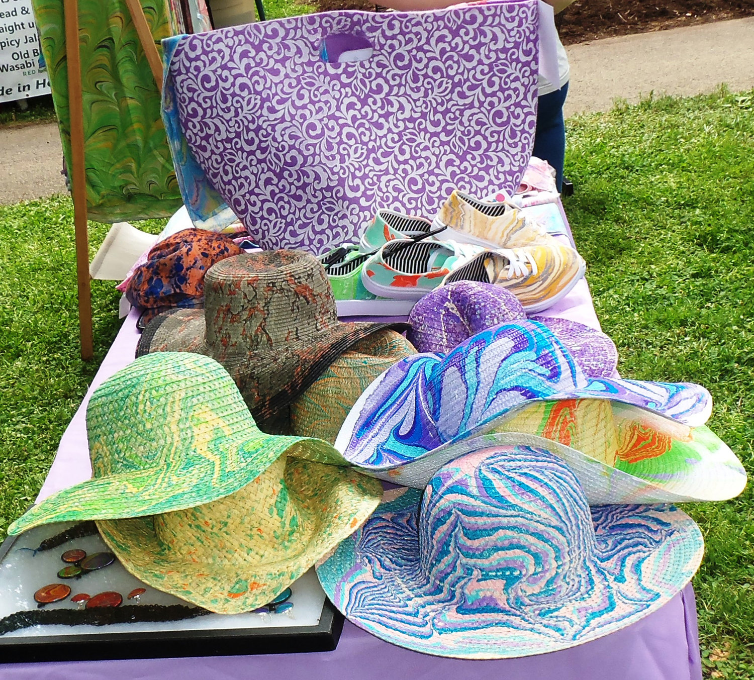 Tie-dye hats were on display next to Stephanie Kelemen's Scarves Happen booth at the Middletown Area Historical Society's Arts & Crafts Fair on June 8.